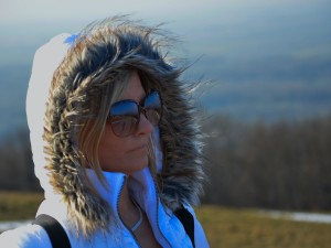 Woman with sunglasses and winter coat