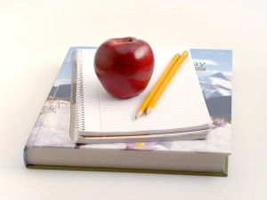 Apple, books and pencils