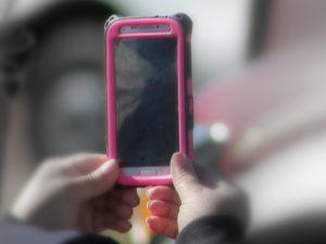 Woman staring at phone screen