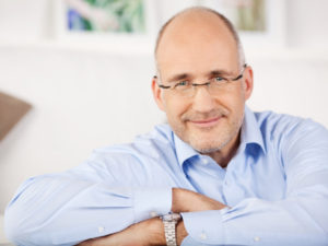 older man with glasses